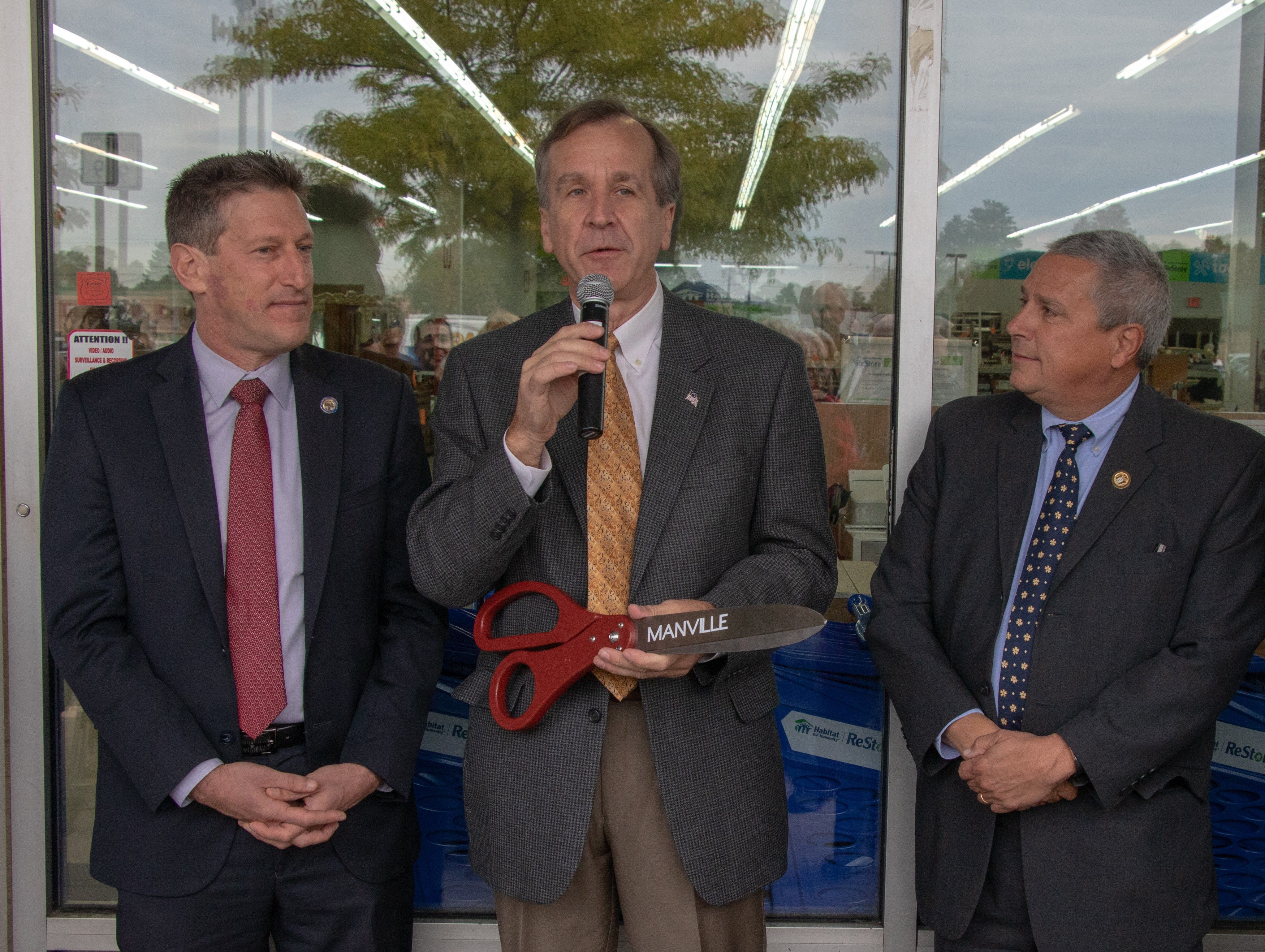 Manville Mayor, Richard Onderko, talks to the crowd at the opening of the new Habitat ReStore in Manville on Oct. 26 at 10 a.m., with Assemblyman Andrew Zwicker to the left and Senator Kip Bateman to the right of Mayor Onderko.