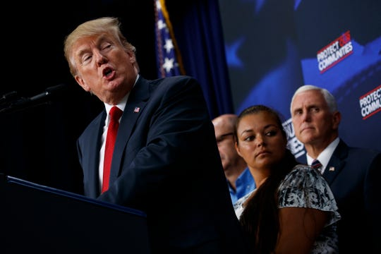 President Donald Trump delivers remarks on immigration alongside family members affected by crime committed by undocumented immigrants — including Kimberly Roberts, a member of Tierra Stansberry's family — at the South Court Auditorium on the White House complex, Friday, June 22, 2018, in Washington. (AP Photo/Evan Vucci)