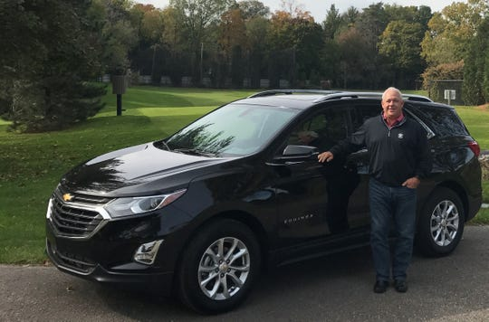 Bloomfield Hills resident B.J. Cameron with his new 2019 Chevrolet Equinox at Stonycroft Hills Club in Bloomfield Hills. An avid golfer, Cameron likes that his clubs fit in the crossover.