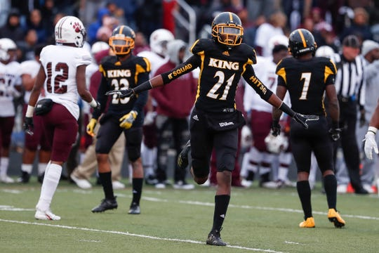 Detroit King defensive back Ahmad Gardner (21) celebrates a tackle against River Rouge during the first half at King High School in Detroit, Friday, Oct. 26, 2018.