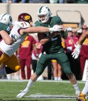 Michigan State quarterback Rocky Lombardi is sacked by Central Michigan defensive lineman Robi Stuart during the second half Sept. 29, 2018 at Spartan Stadium.