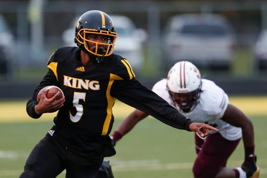 Detroit King quarterback Dequan Finn runs against River Rouge during the first half at King High School in Detroit, Friday, Oct. 26, 2018.