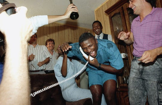 Bennie Blades, a former safety with the Miami Hurricanes, tries to duck under champagne in Fort Lauderdale, Fla., after getting the call from the Detroit Lions saying he is their first pick in the 1988 NFL draft, April 24, 1988. Blades was the third pick overall.