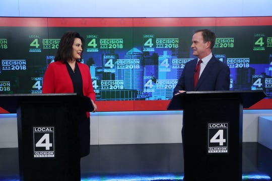 Michigan Democratic gubernatorial candidate Gretchen Whitmer and Republican Bill Schuette, talk before their second debate last week.