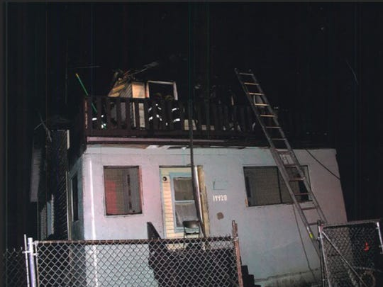 A dog trained to detect accelerants indicated he smelled one on the second floor of the house that was firebombed.