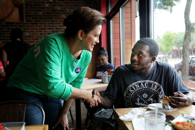 Gubernatorial Democratic Candidate Gretchen Whitmer shakes hands with prospective voter Jordan Dagnogo, 25, of Detroit at Kuzzo's Chicken and Waffles on the Livernois Avenue of Fashion in Detroit.