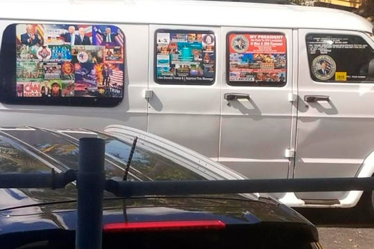 This Nov. 1, 2017, photo shows a van with windows covered with an assortment of stickers in Well, Fla.