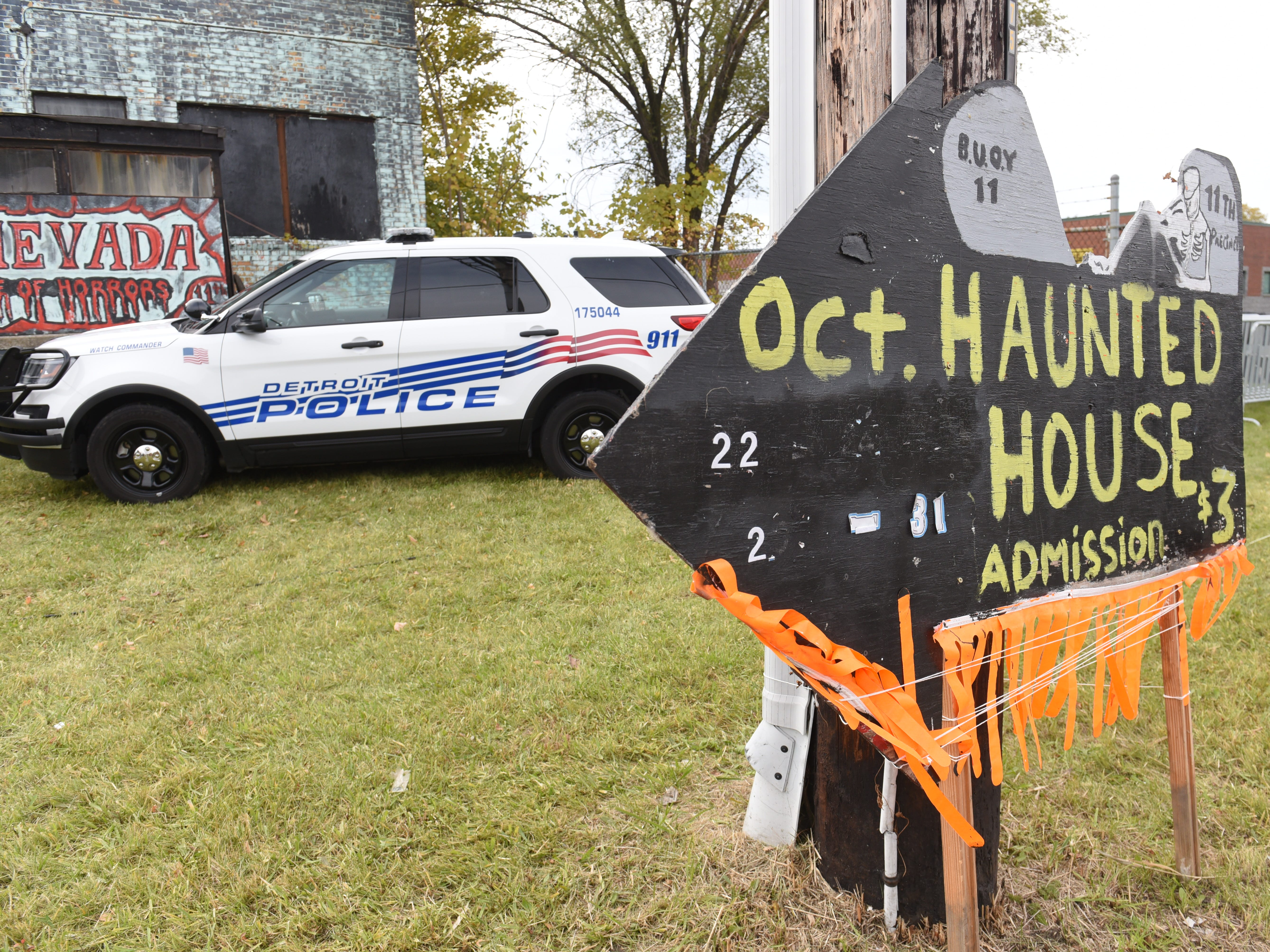 "Detroit Police Department's 11th precinct ""Haunted House"" serves as a backdrop to Police Chief James Craig's announcement."