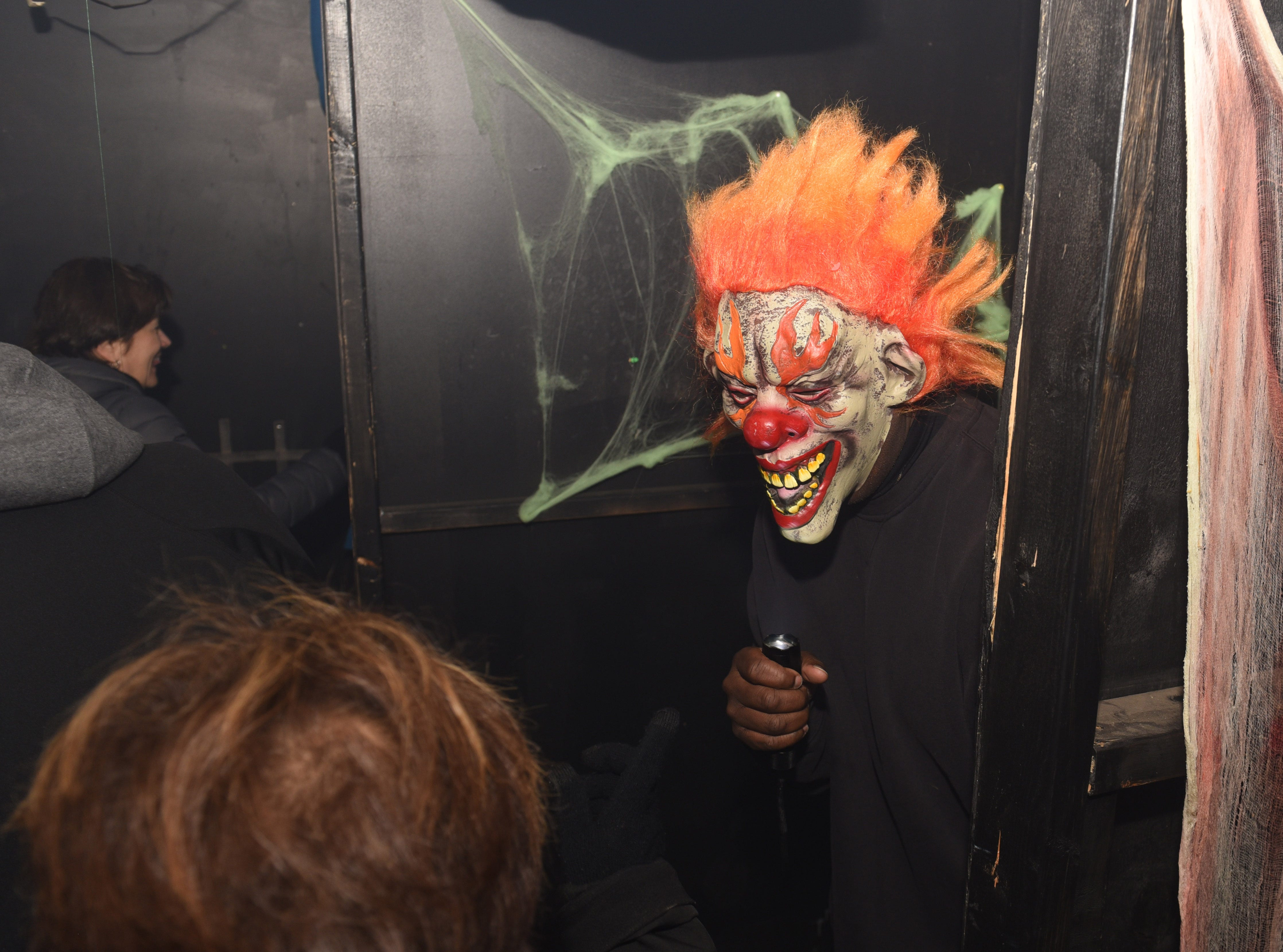 "A scary beast occupies the Detroit Police Department's 11th precinct ""Haunted House"" Friday in Detroit."