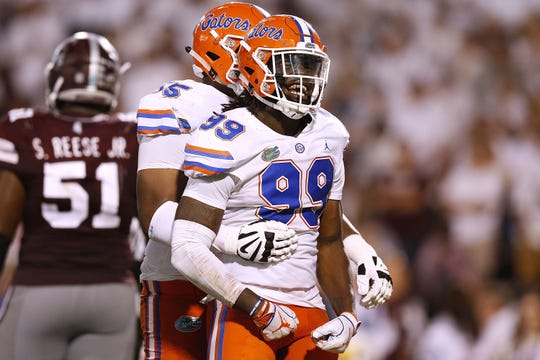 Florida's Jachai Polite (99) celebrates a sack against Mississippi State earlier this season.