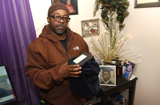 Maurice Wise holds the remains of his uncle Lorance Wise which he received in his Detroit home on Friday,  October 26, 2018.