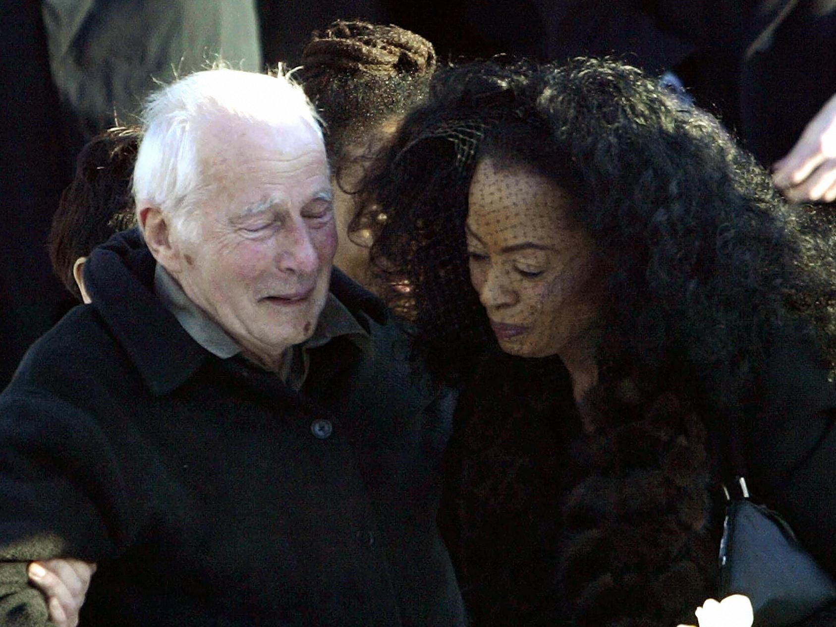 In 2004, Ross' ex-husband Arne Naess Jr.  plunged to his death from a cliff as he tried to descend a mountain in South Africa.  Above, Ross attends the Jan. 21 funeral in Oslo, Norway, mourning with her former father-in-law, Arne Naess.