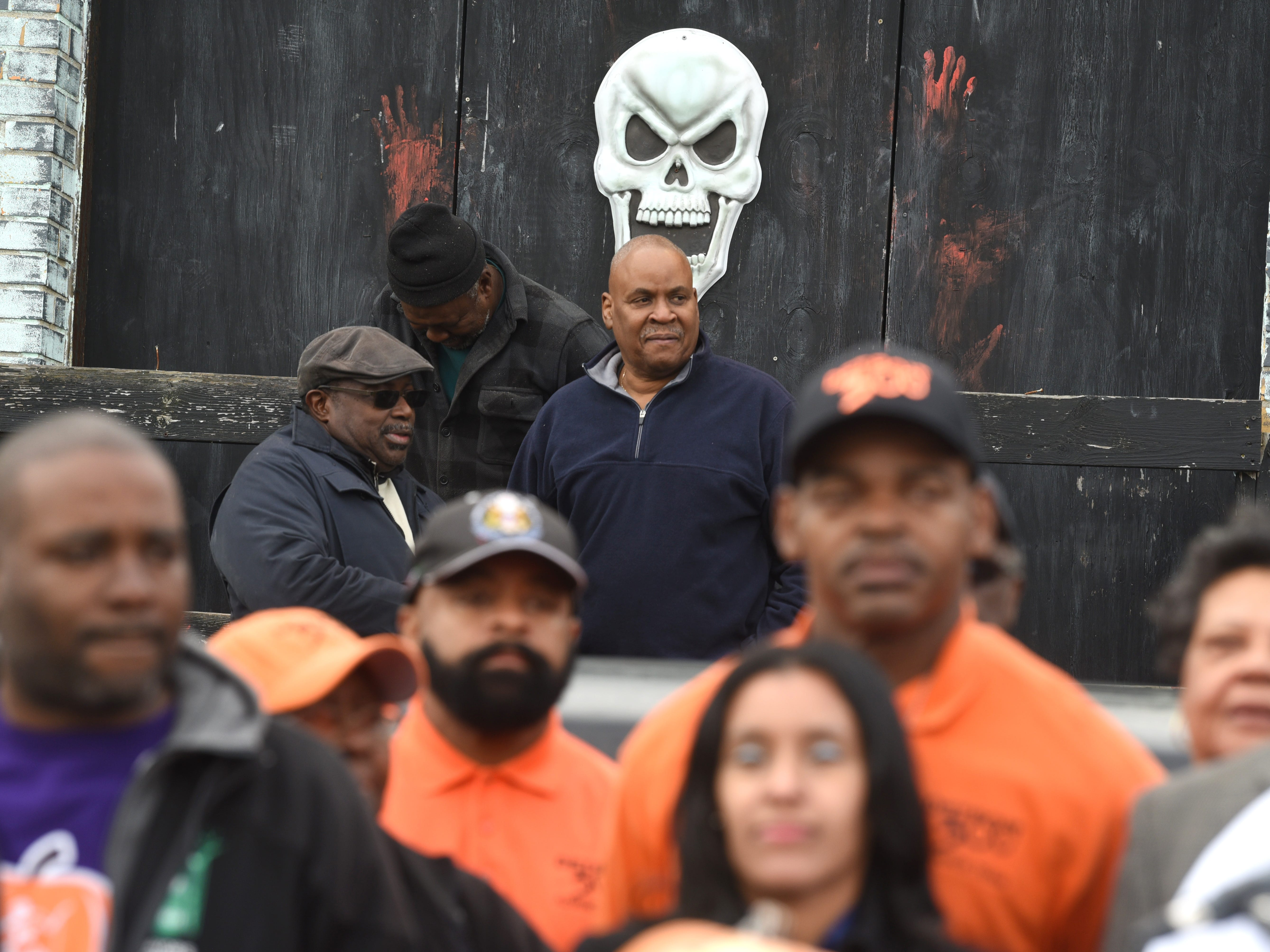 "A skull looms outside Detroit Police Department's 11th precinct ""Haunted House"" as Detroit Police Chief James Craig speaks about the city's new Halloween in the D."