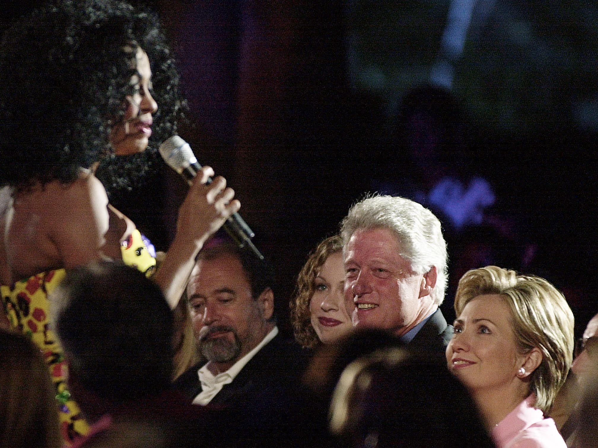 President Bill Clinton and first lady Hillary Clinton listen to Diana Ross sing at the Gala Hollywood Farewell Salute to President Clinton on Aug. 12, 2000 in Hollywood.