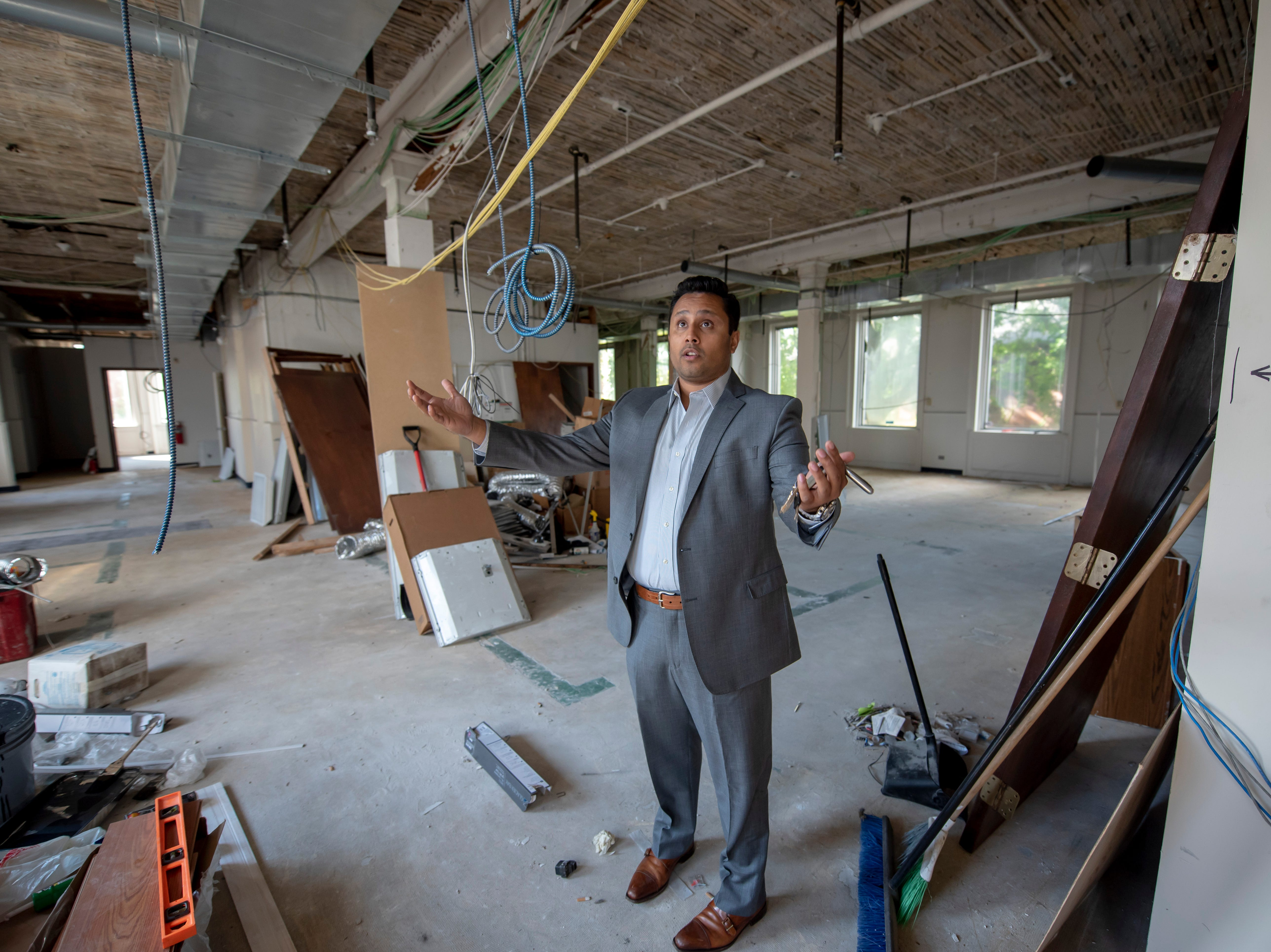 Rush Hasan, operations and business development for The Reef, stands inside the former Port of Detroit building that is slated to be the company's new location.