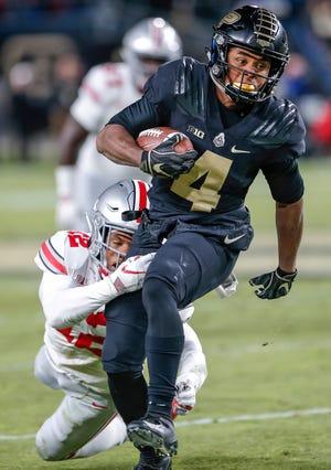 Purdue freshman receiver Rondale Moore (4) already has five 100-yard receiving games this season.