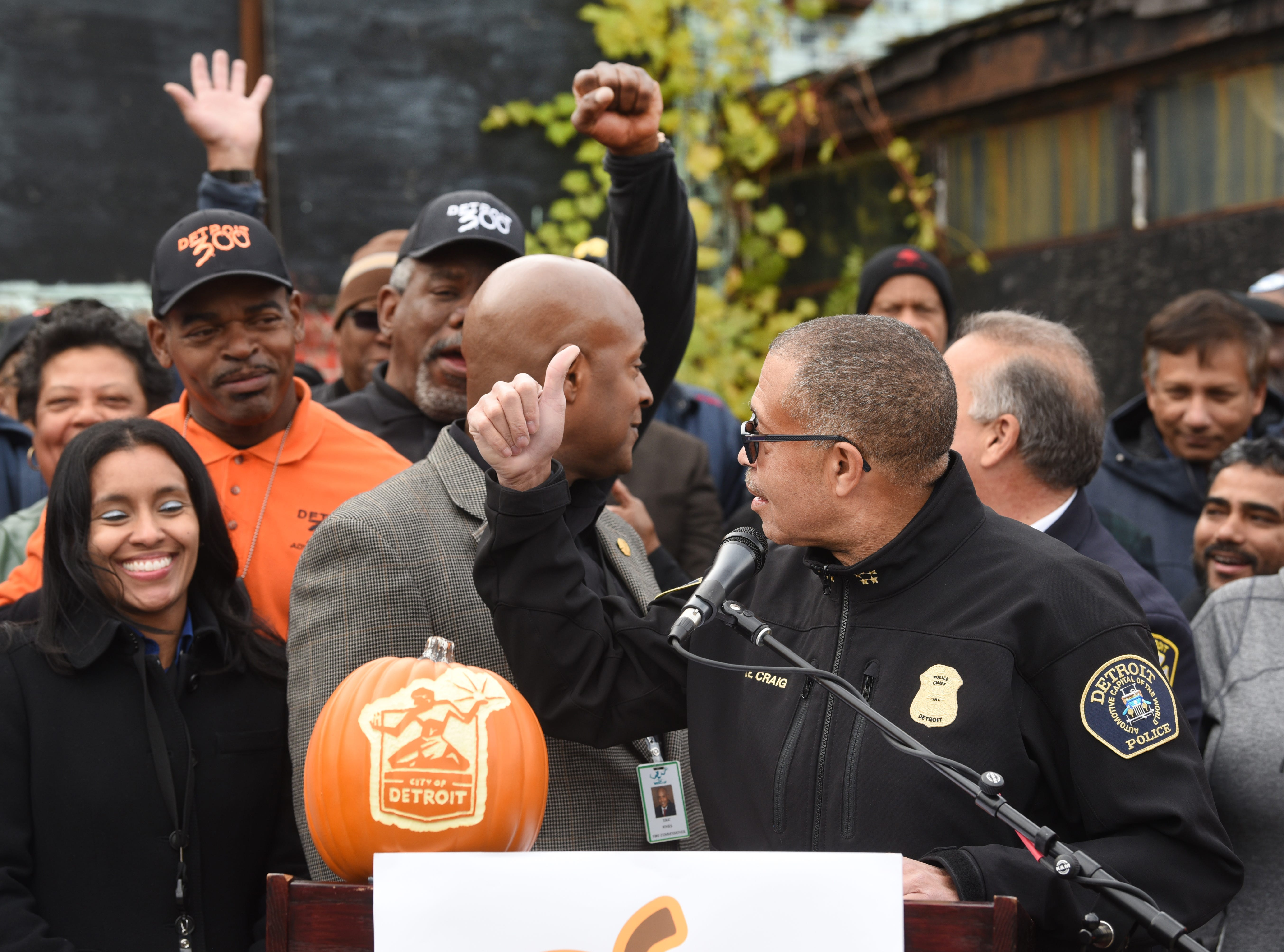 "Detroit Police Chief James Craig gives a thumbs-up to members of the Detroit 300 outside the DPD's 11th precinct ""Haunted House."""