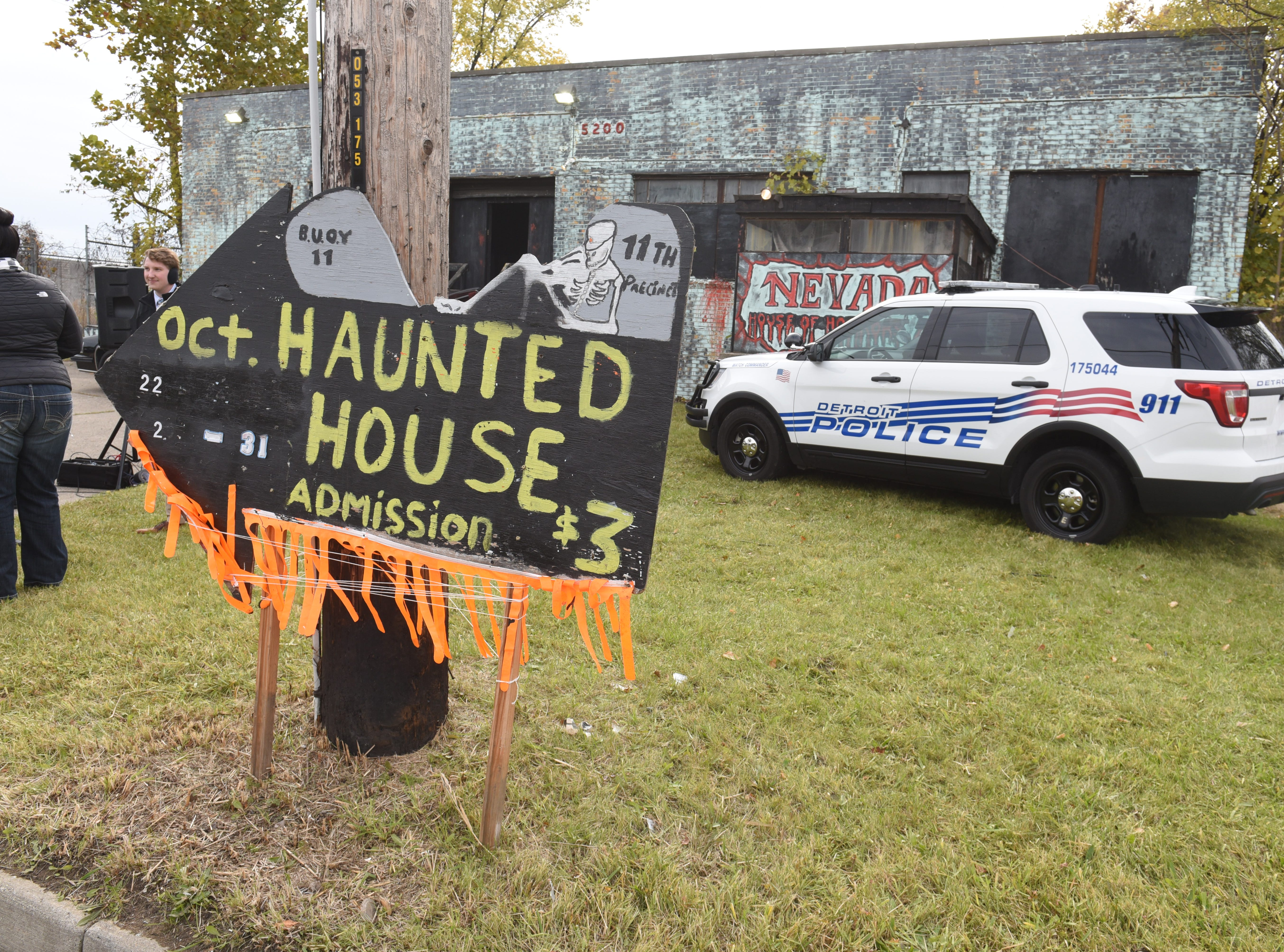 "Detroit Police Department's 11th precinct ""Haunted House"" serves as a backdrop as Police Chief James Craig speaks Friday about the city's new Halloween in the D celebration."