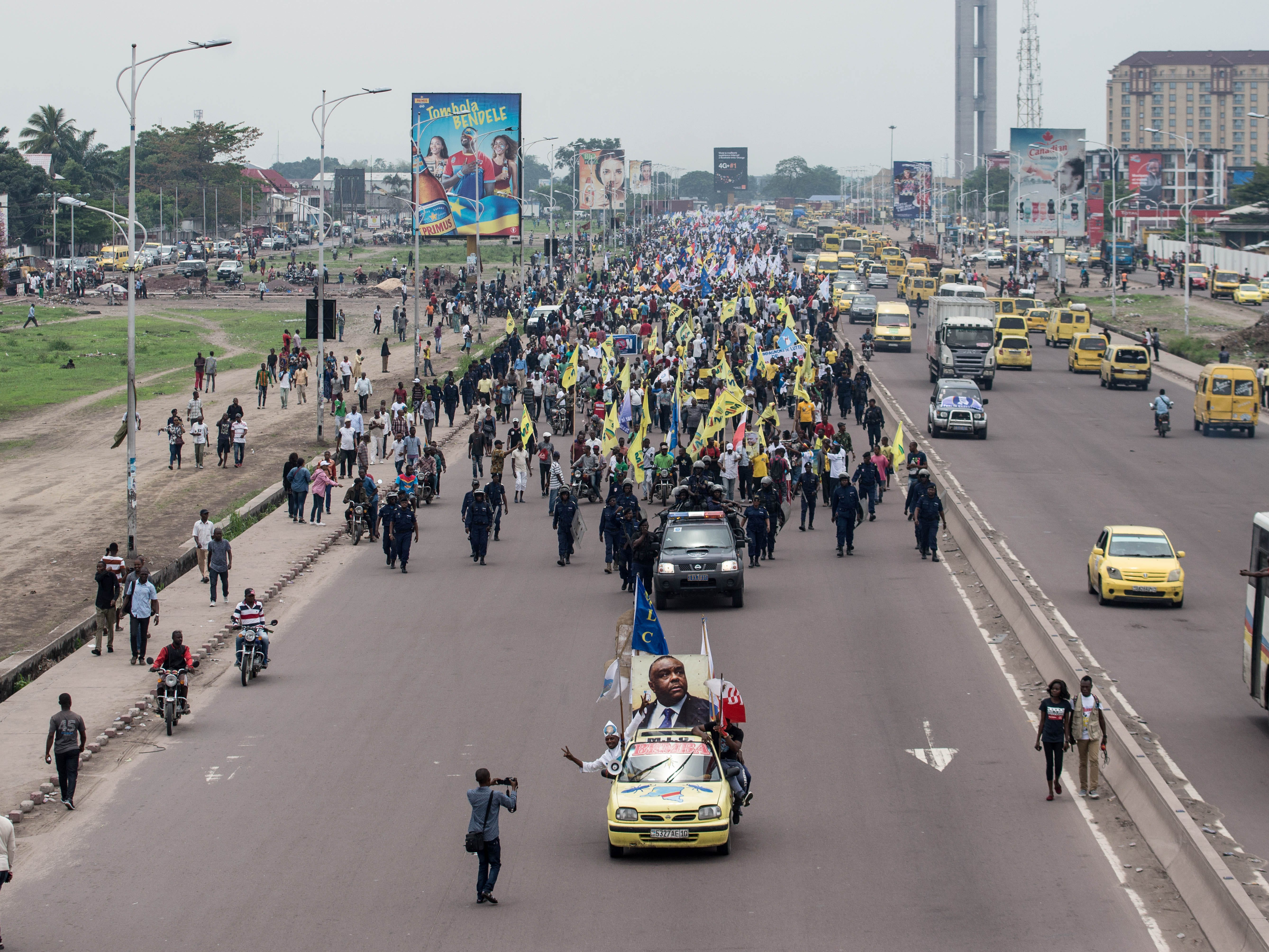 Opposition supporters demonstrate against the electoral process scheduled for the December elections near the capital of Kinshasa, on Oct. 26, 2018. Thousands rallied across the Democratic Republic of Congo seeking the withdrawal of electronic voting machines in a long-delayed election due at the end of December, saying they would be misused to rig the results.