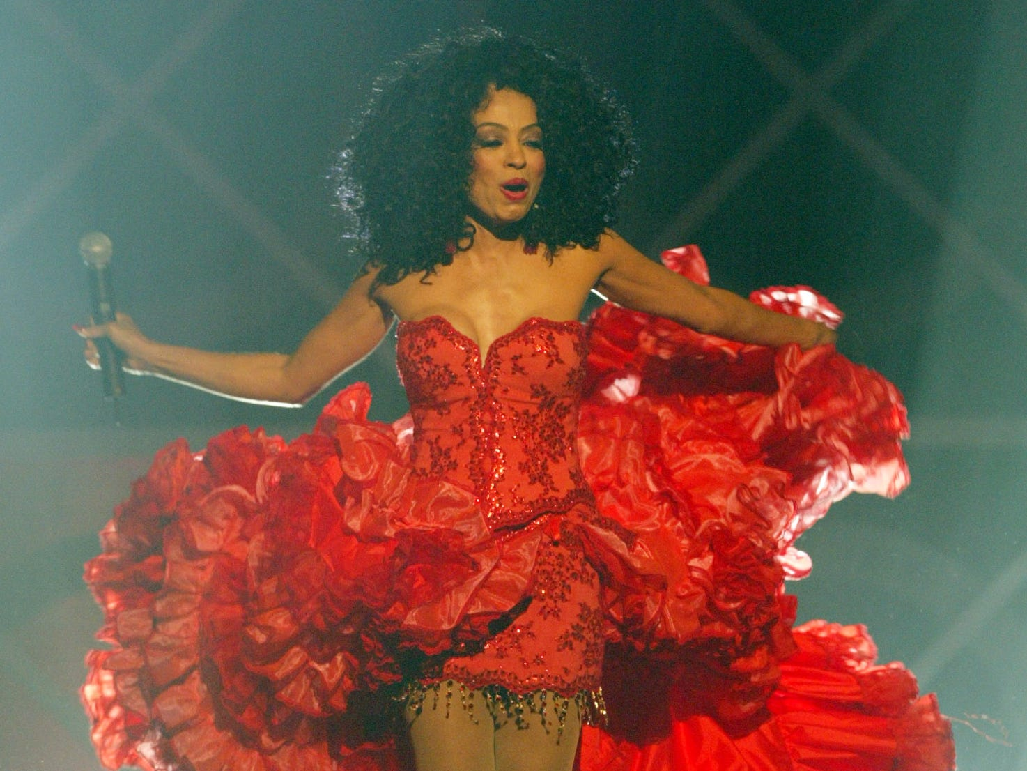 "Diana Ross performs Dec. 8, 2004 at the Billboard Music Awards in Las Vegas.  That year, she wrote the second volume of her autobiography, ""Wrong Turns, Right Turns and the Road Ahead."""