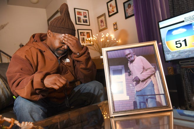 Maurice Wise gets emotional as he talks about his uncle Lorance Wise, whose photo is displayed in his home. Maurice Wise had his uncle cremated in 2013 at Cantrell Funeral Home and was told that his ashes were interred at the Great Lakes National Cemetery in Holly.