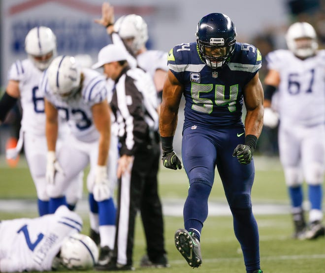 Middle linebacker Bobby Wagner (54) is the key cog in Seattle's defense.