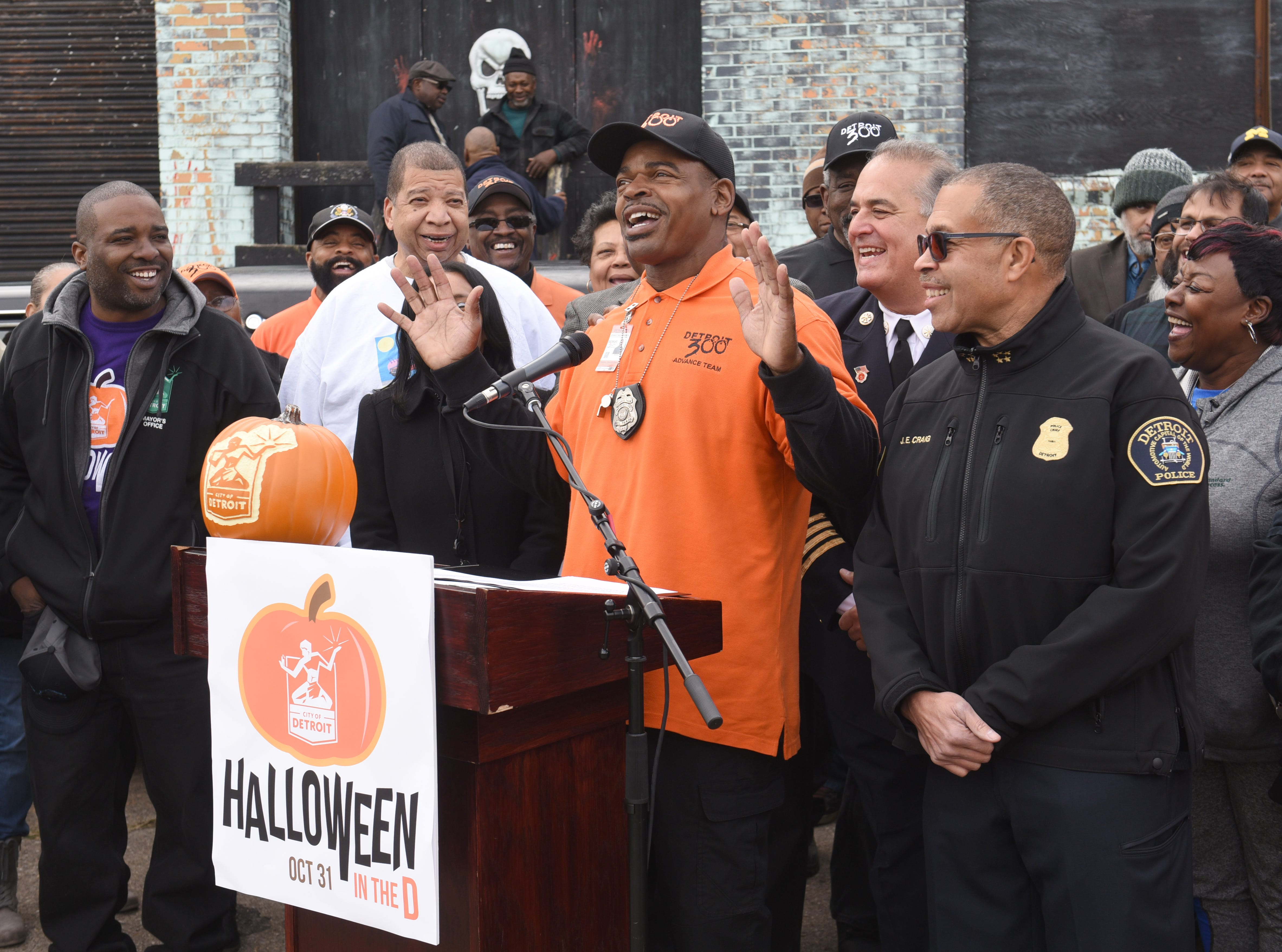"Eric Ford, center, of the Detroit 300, reacts to his comments on ""Hollywood in the D"" outside the 11th precinct's ""Haunted House."""