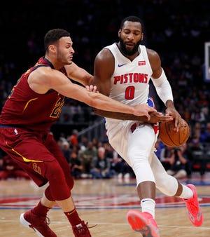 Cavaliers forward Larry Nance Jr., left, knocks the ball away from Pistons center Andre Drummond during Thursday's game.