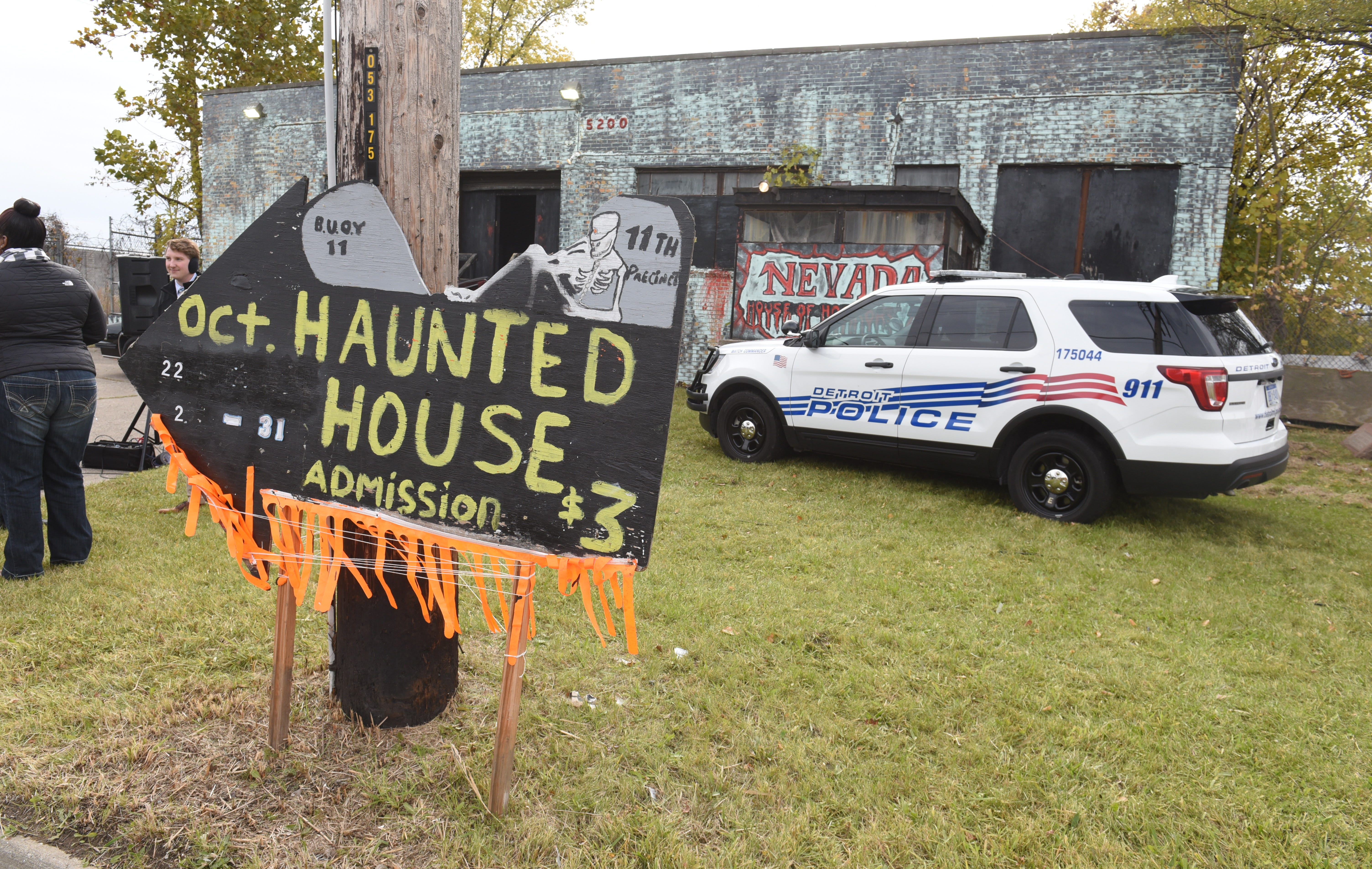 """The Detroit Police Department's 11th precinct """"Haunted House"""" served as a backdrop as Police Chief James Craig spoke about the city's new Halloween in the D celebration Friday."""