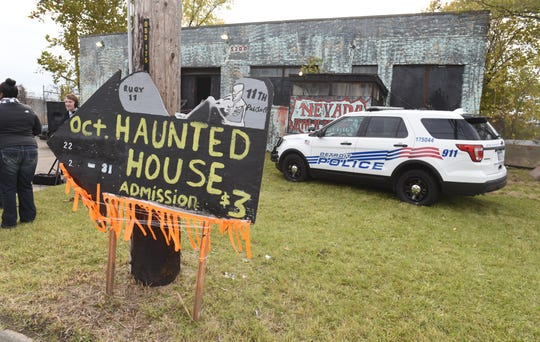 "The Detroit Police Department's 11th precinct ""Haunted House"" served as a backdrop as Police Chief James Craig spoke about the city's new Halloween in the D celebration Friday."