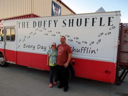 Courtney and Nick Duffy with their successful food truck, the Duffy Shuffle. When you see them, stop for a fried avocado taco.