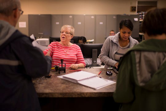 Election clerks Shirley Mangold, left, and Tersha Reed get early voters prepared to vote at the Vanderburgh County Election Office Friday morning.