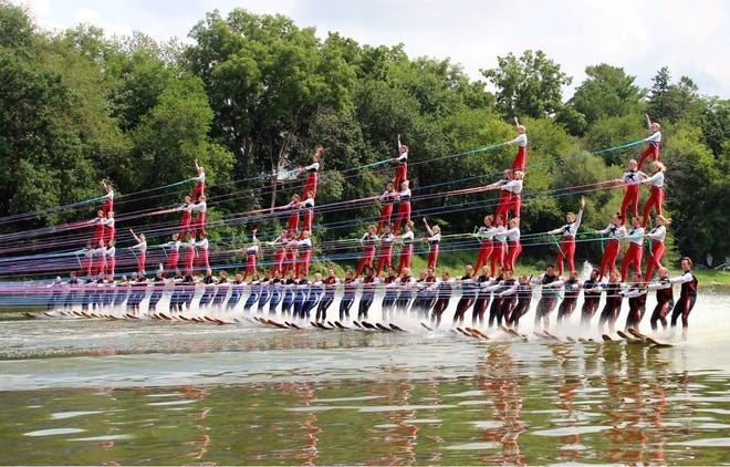 """A team of 80 skiers broke the record for """"the largest human pyramid on water skis,"""" on Aug. 18 while using boats powered by Mercury Marine engines."""