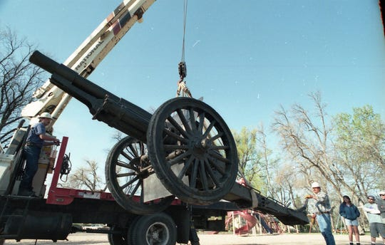The cannon being removed from City Park in 1997. It would be returned and rededicated July 4 of that same year.