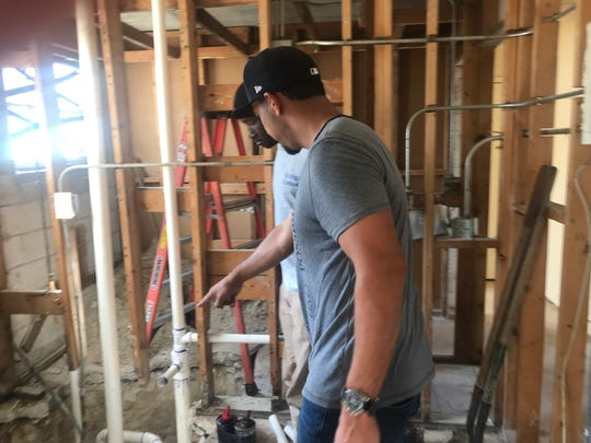Felix Reyes of Treetop Development inspects the connections on new PVC plumbing in a resident's apartment at Fort Myers' Jones Walker apartments on Thursday. The PVC replaces 40-year-old cast iron pipes that caused continual leaks and collapsed ceilings. Under pressure from residents, city council members and Senators Rubio and Nelson, Treetop, which inherited decades of deferred maintenance when it bought Jones Walker in 2014, is doing a thorough rehab.