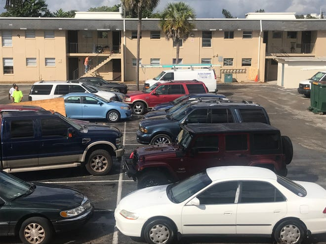 Fort Myers' Jones Walker apartments were a hub of construction activity Thursday as owner Treetop Development and work crews race to complete a top-down capital improvement under penalty of $250-a-day code enforcement fines and the threat of losing its HUD contract.