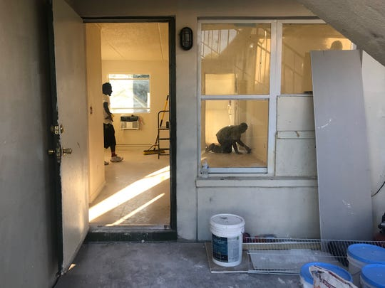 New hurricane resistant windows (right) are part of a major rehab at Fort Myers' Jones Walker apartments under pressure from HUD. Owner Treetop Development is racing to complete a long punch list of improvements at a rate of 10 apartments a day.
