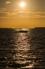 Boaters make their way to the Cape Coral Yacht Club close to sunset.
