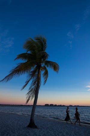 Visitors to the Cape Coral Yacht Club enjoy a serene sunset.