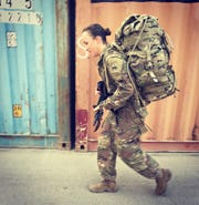 Staff Sgt. Amanda Kelley of Easley, with rucksack.