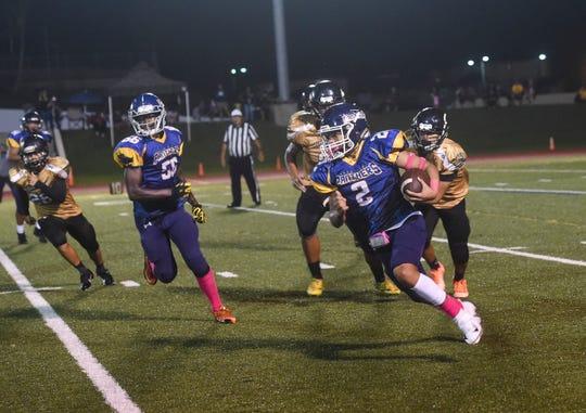 Guam High quarterback Travon Jacobs (2) runs the ball against the John F. Kennedy Islanders during their IIAAG High School Football third place playoff game at the Guam High School field, Oct. 26, 2018.