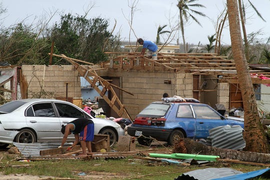 Saipan residents pick up the pieces after Super Typhoon Yutu damaged their houses.