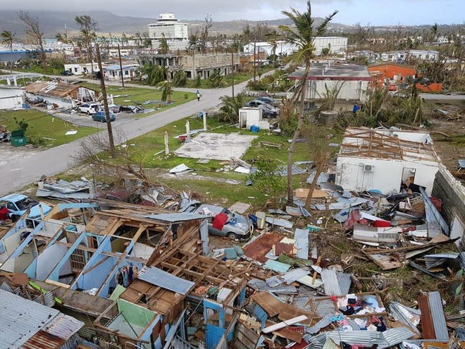 A nearly decimated cluster of houses in central Saipan because of Super Typhoon Yutu.