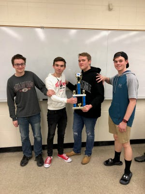 Henderson County High School quick recall team members Wil Kyle, Harrison Jenkins, DJ Banks and Alex Chandler pose with the first place trophy after winning the University of Kentucky Fall Championship Tournament, Oct. 13, 2018.