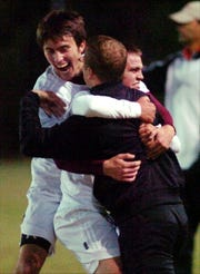 Brian Crafton, who was the head coach of the Henderson County boys soccer program, celebrates the 2008 Third Region championship with players Ryan Lingerfelt, left, and Jordan Gregory.