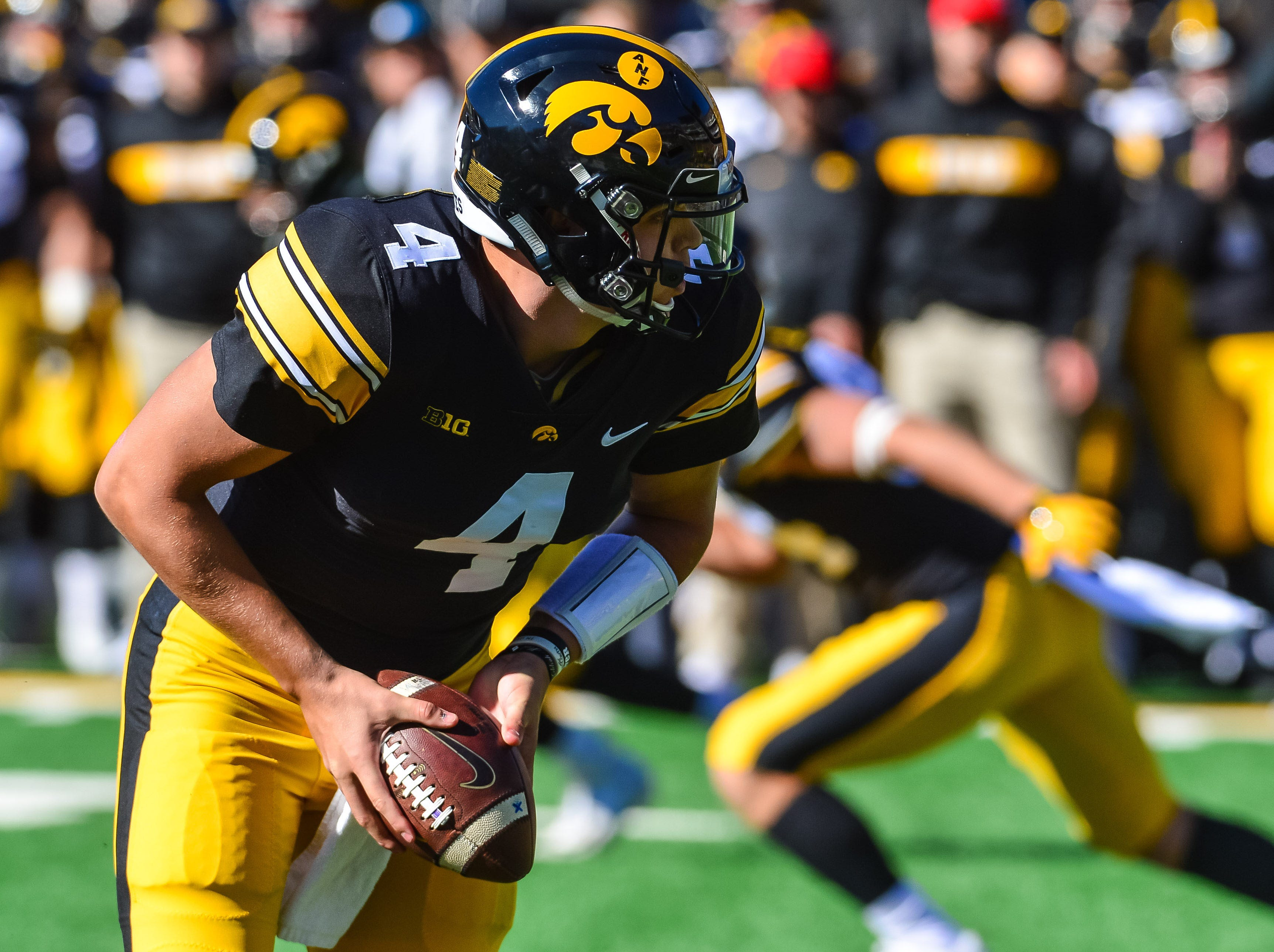 Iowa Hawkeyes quarterback Nate Stanley looks to make a handoff during the first quarter against the Maryland Terrapins on Oct. 20, 2018 at Kinnick Stadium.