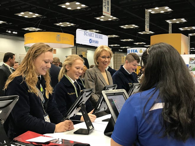 U.S. Secretary of Education Betsy DeVos plays a trivia game with students at the National FFA Convention in Indianapolis on Friday, Oct. 26, 2018.