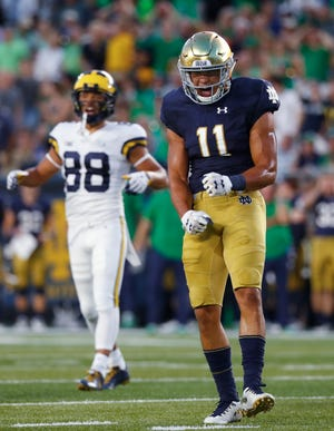 Notre Dame safety Alohi Gilman (11) reacts to a play against Michigan in the first half of an NCAA football game in South Bend, Ind., Saturday, Sept. 1, 2018. (AP Photo/Paul Sancya)
