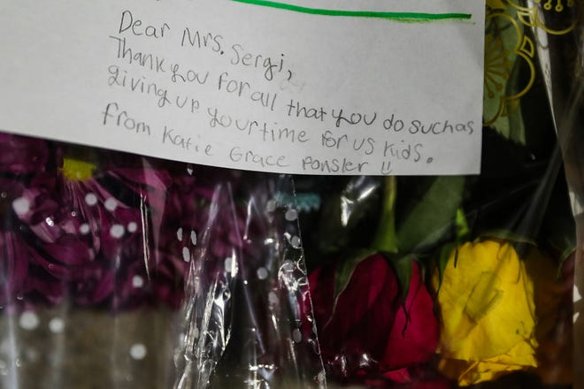 Community members and students left flowers and notes during a vigil for Hamilton Southeastern School teachers Kristal Sergi and Frank Sergi outside Hoosier Road Elementary in Fishers, Ind., Thursday, Oct. 25, 2018. Kristal, a preschool teacher at Hoosier Road, and Frank, an art teacher at Fall Creek Intermediate, were found dead in their Fishers home Wednesday night, Oct. 24, 2018. The couple was amidst divorce proceedings and the police said they are not looking for a suspect in the deaths.