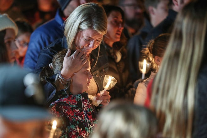 Children, parents and community members gathered for a candlelight vigil remembering teachers Kristal Sergi and Frank Sergi, at Hoosier Road Elementary in Fishers, Ind., Thursday, Oct. 25, 2018. Kristal, a preschool teacher at Hoosier Road, and Frank, an art teacher at Fall Creek Intermediate, were found dead in their Fishers home Wednesday night, Oct. 24, 2018. The couple was amidst divorce proceedings and the police said they are not looking for a suspect in the deaths.